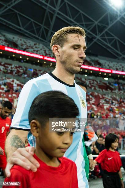 Lucas Biglia of Argentina getting into the field during the International Test match between Argentina and Singapore at National Stadium on June 13...