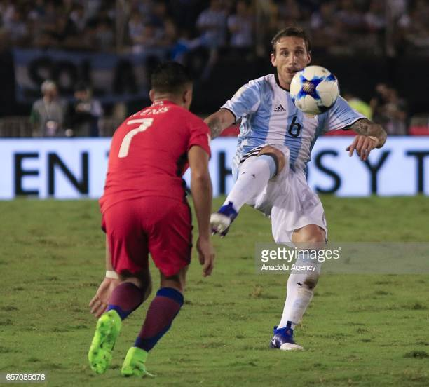 Lucas Biglia of Argentina in action against Alexis Sanchez of Chile during the FIFA 2018 World Cup Qualifiers football match between Argentina and...