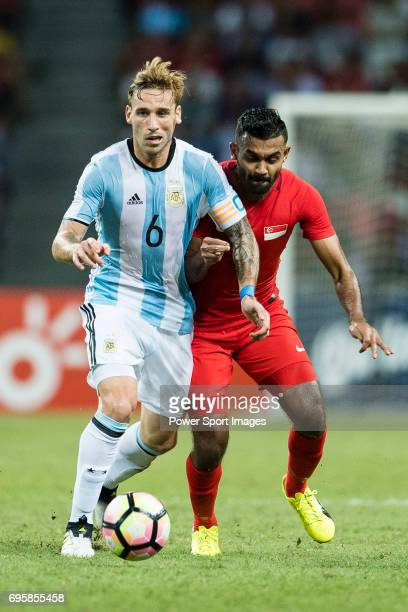 Lucas Biglia of Argentina in action against Faritz Hameed of Singapore during the International Test match between Argentina and Singapore at...
