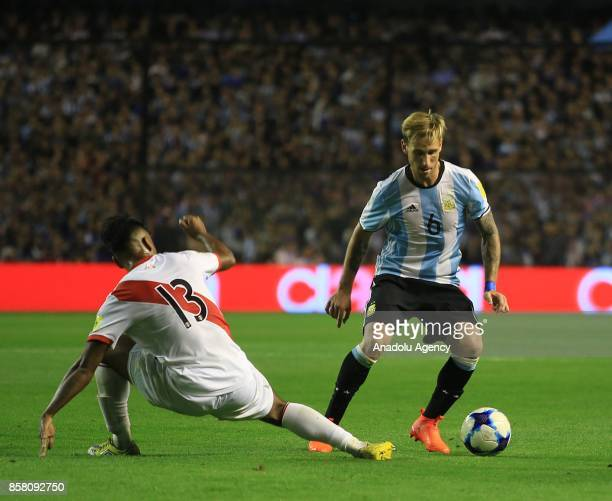 Lucas Biglia of Argentina in action against Renato Tapia of Peru during the 2018 FIFA World Cup Qualification match between Argentina and Peru at the...