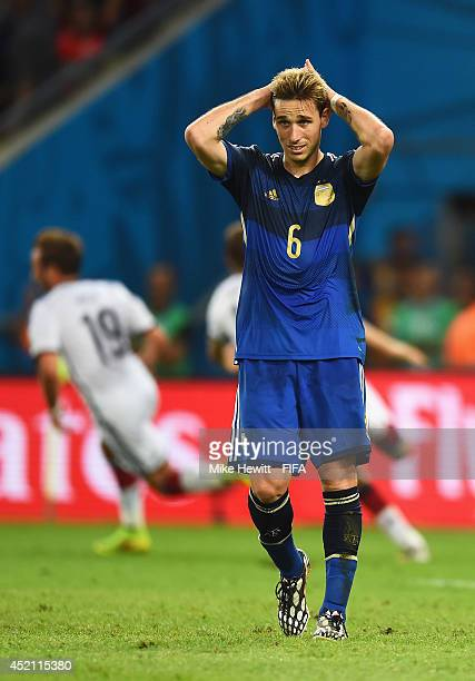 Lucas Biglia of Argentina looks on dejected after Germany win the 2014 FIFA World Cup Brazil Final match between Germany and Argentina at Maracana on...