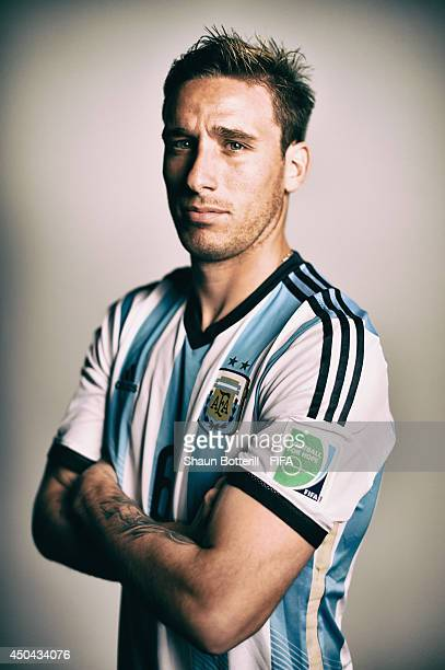 FILTERS Lucas Biglia of Argentina poses during the official FIFA World Cup 2014 portrait session on June 10 2014 in Belo Horizonte Brazil