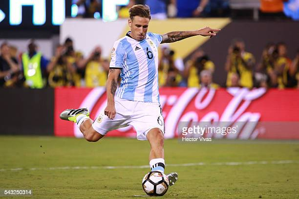 Lucas Biglia of Argentina takes a penalty shot during the championship match between Argentina and Chile at MetLife Stadium as part of Copa America...