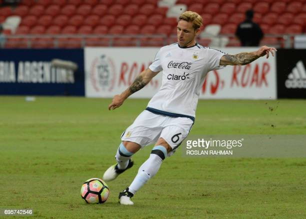 Lucas Biglia of Argentina warms up before the start of their international friendly football match against Singapore at the National Stadium in...