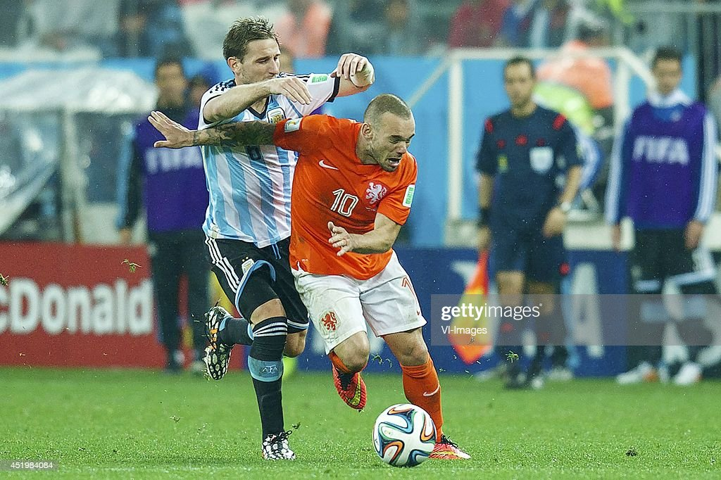 Lucas Biglia of Argentina, Wesley Sneijder of Holland during the match between The Netherlands and Argentina on July 9, 2014 at Arena de Sao Paulo in Sao Paulo, Brazil.