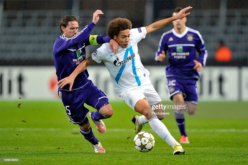 Lucas Biglia of RSC Anderlecht (L) battles for the ball with Axel Witsel of FC Zenit St Petersburg during the UEFA Champions League Group C match between RSC Anderlecht and FC Zenit St Petersburg at the Constant Vanden Stock Stadium on November 6, 2012 in Brussels, Belgium.