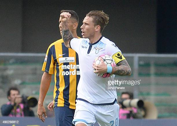 Lucas Biglia of SS Lazio celebrates after scoring his team's first goal from the penalty spot during the Serie A match between Hellas Verona FC and...