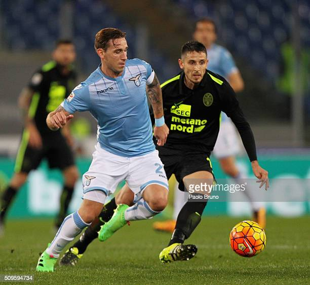 Lucas Biglia of SS Lazio competes for the ball with Leandro Greco of Hellas Verona FC during the Serie A match between SS Lazio and Hellas Verona FC...
