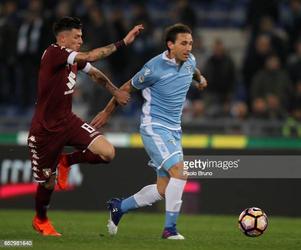 Lucas Biglia of SS Lazio competes for the ball with Marco Benassi FC Torino during the Serie A match between SS Lazio and FC Torino at Stadio...