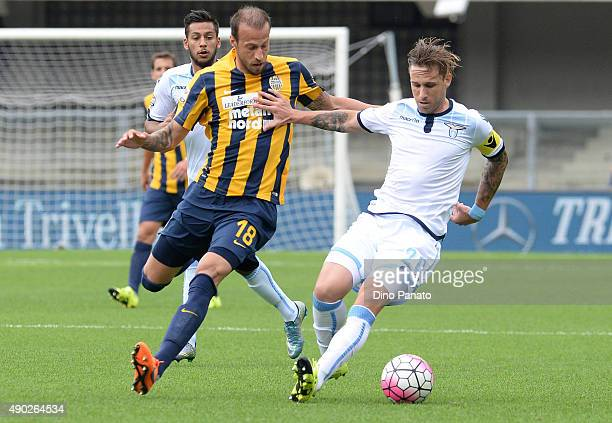 Lucas Biglia of SS Lazio competes with Evangelos Moras of Hellas Verona during the Serie A match between Hellas Verona FC and SS Lazio at Stadio...