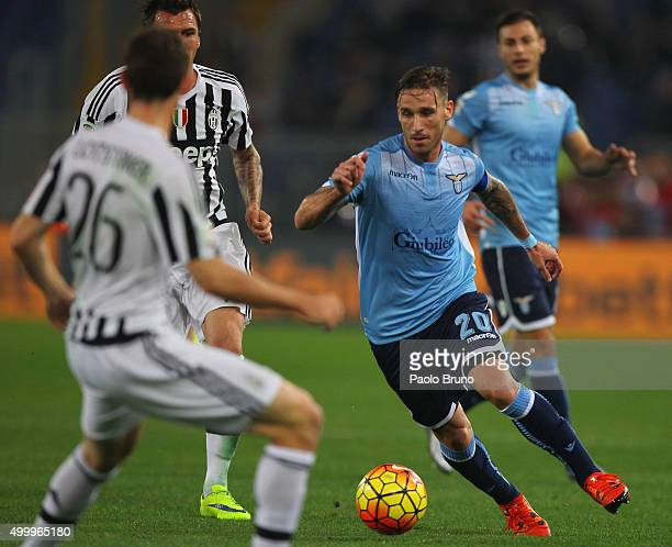 Lucas Biglia of SS Lazio in action against Juventus FC players during the Serie A match between SS Lazio and Juventus FC at Stadio Olimpico on...