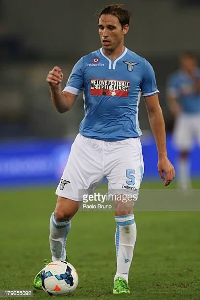 Lucas Biglia of SS lazio in action during the Serie A match between SS Lazio and Udinese Calcio at Stadio Olimpico on August 25 2013 in Rome Italy
