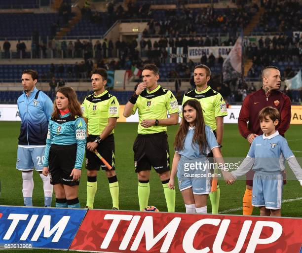 Lucas Biglia of SS Lazio referee Massimiliano Irrati and Radja Nainggolan of AS Roma prior the TIM Cup match between SS Lazio and AS Roma at Olimpico...