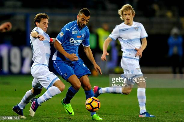 Lucas Biglia Savic of SS Lazio compete for the ball with Omas El Kaddouri of Empoli FC during the Serie A match between Empoli FC and SS Lazio at...
