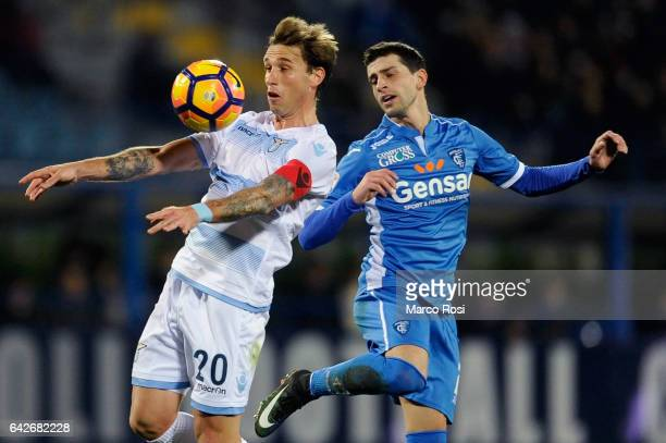 Lucas Biglia Savic of SS Lazio competes for the ball with Manuel Pucciarelli of Empoli FC during the Serie A match between Empoli FC and SS Lazio at...