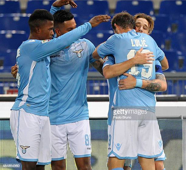 Lucas Biglia with his teammates of SS Lazio celebrates after scoring the opening goal during the Serie A match between SS Lazio and Bologna FC at...
