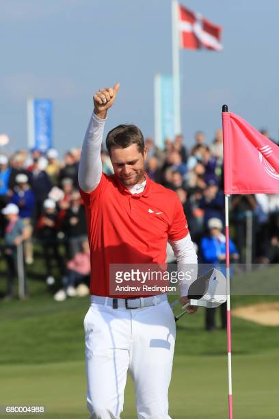 Lucas Bjerregaard of Denmark celebrates victory on the 6th green during the final match between Denmark and Australia during day two of GolfSixes at...