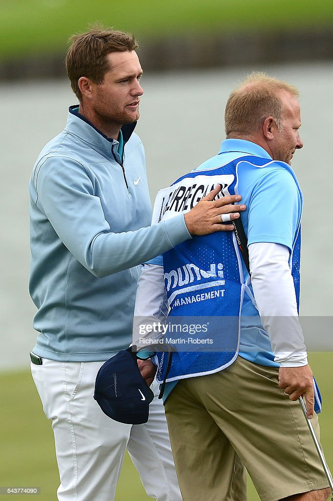 <a gi-track='captionPersonalityLinkClicked' href=/galleries/search?phrase=Lucas+Bjerregaard&family=editorial&specificpeople=6215709 ng-click='$event.stopPropagation()'>Lucas Bjerregaard</a> of Denmark gives his caddie Todd a pat on the back on the 18th green during the first round of the 100th Open de France at Le Golf National on June 30, 2016 in Paris, France.