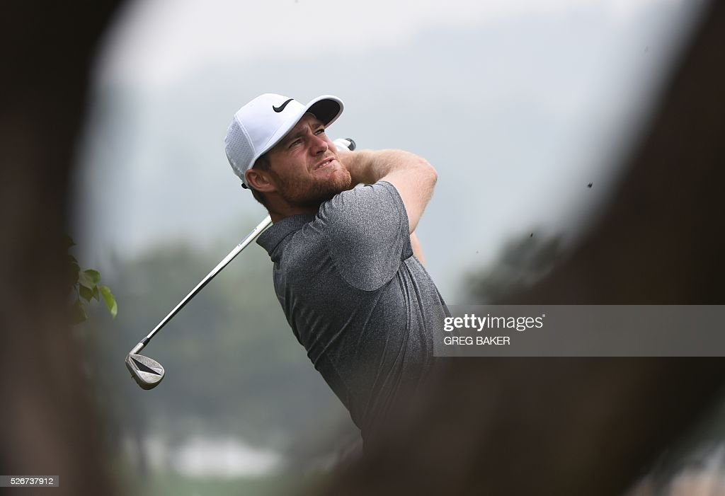 Lucas Bjerregaard of Denmark hits a shot during the final round of the Volvo China Open golf tournament in Beijing on May 1, 2016. / AFP / GREG