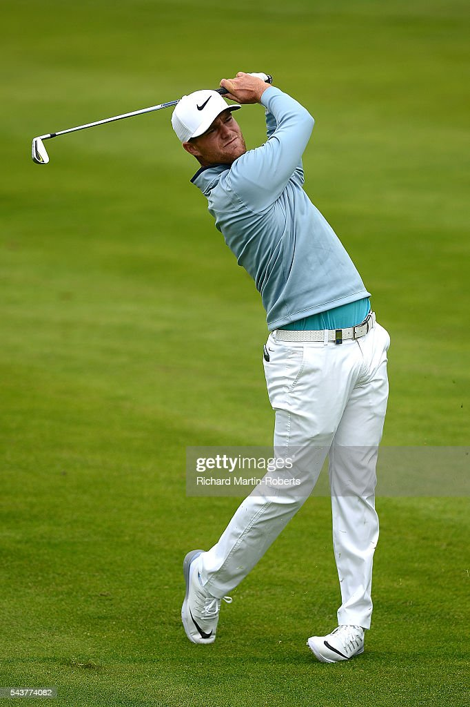 <a gi-track='captionPersonalityLinkClicked' href=/galleries/search?phrase=Lucas+Bjerregaard&family=editorial&specificpeople=6215709 ng-click='$event.stopPropagation()'>Lucas Bjerregaard</a> of Denmark hits his 2nd shot on the 17th hole during the first round of the 100th Open de France at Le Golf National on June 30, 2016 in Paris, France.