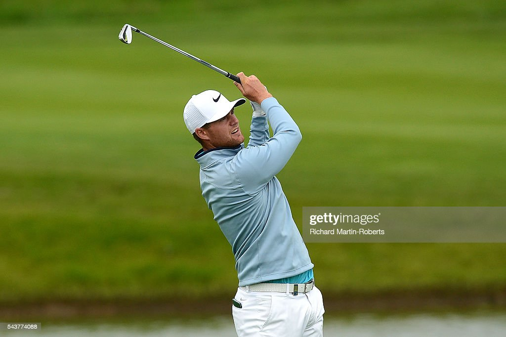 <a gi-track='captionPersonalityLinkClicked' href=/galleries/search?phrase=Lucas+Bjerregaard&family=editorial&specificpeople=6215709 ng-click='$event.stopPropagation()'>Lucas Bjerregaard</a> of Denmark hits his 2nd shot on the 18th hole during the first round of the 100th Open de France at Le Golf National on June 30, 2016 in Paris, France.