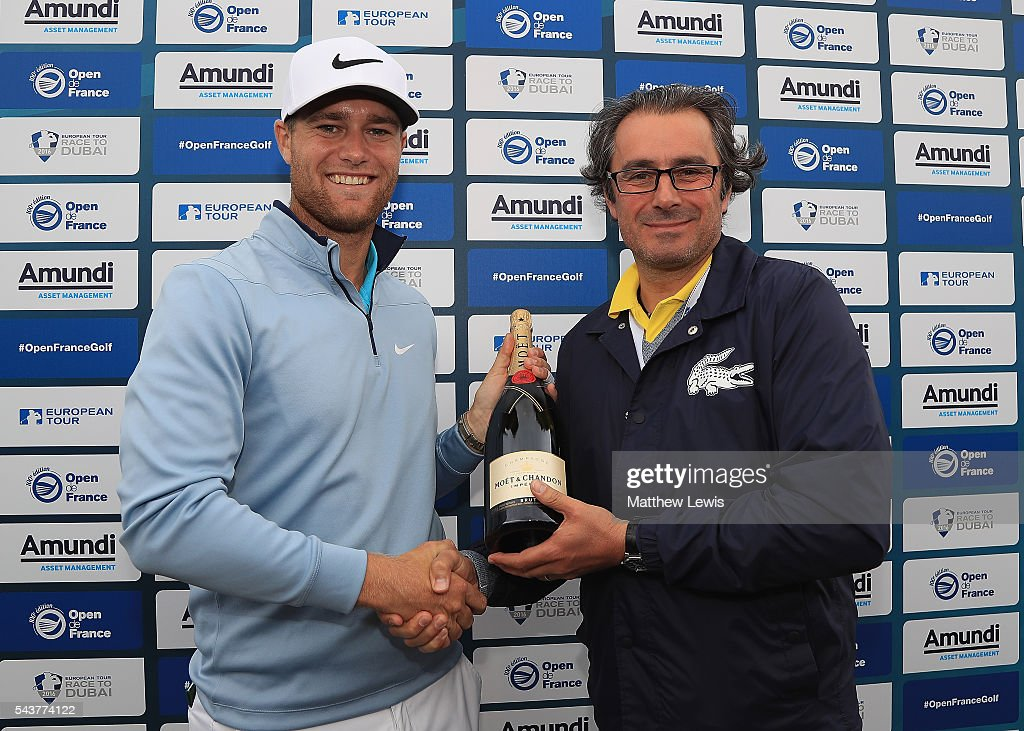 <a gi-track='captionPersonalityLinkClicked' href=/galleries/search?phrase=Lucas+Bjerregaard&family=editorial&specificpeople=6215709 ng-click='$event.stopPropagation()'>Lucas Bjerregaard</a> of Denmark is presented with a magnum of champagne by Jean van de Velde, Tournamnet Director, after making a hole in one on the second hole during day one of the 100th Open de France at Le Golf National on June 30, 2016 in Paris, France.