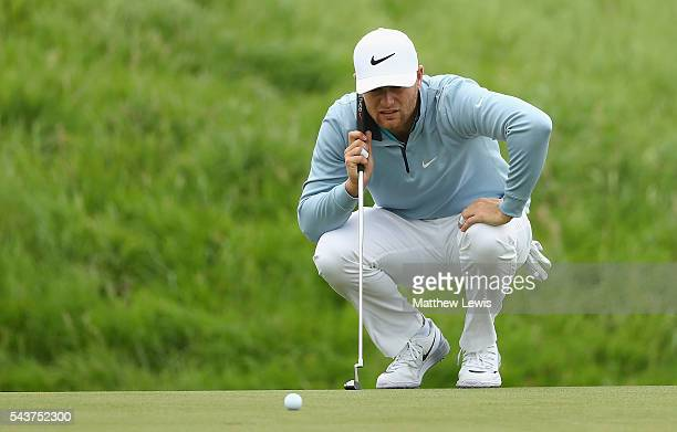 Lucas Bjerregaard of Denmark lines up a putt during day one of the 100th Open de France at Le Golf National on June 30 2016 in Paris France
