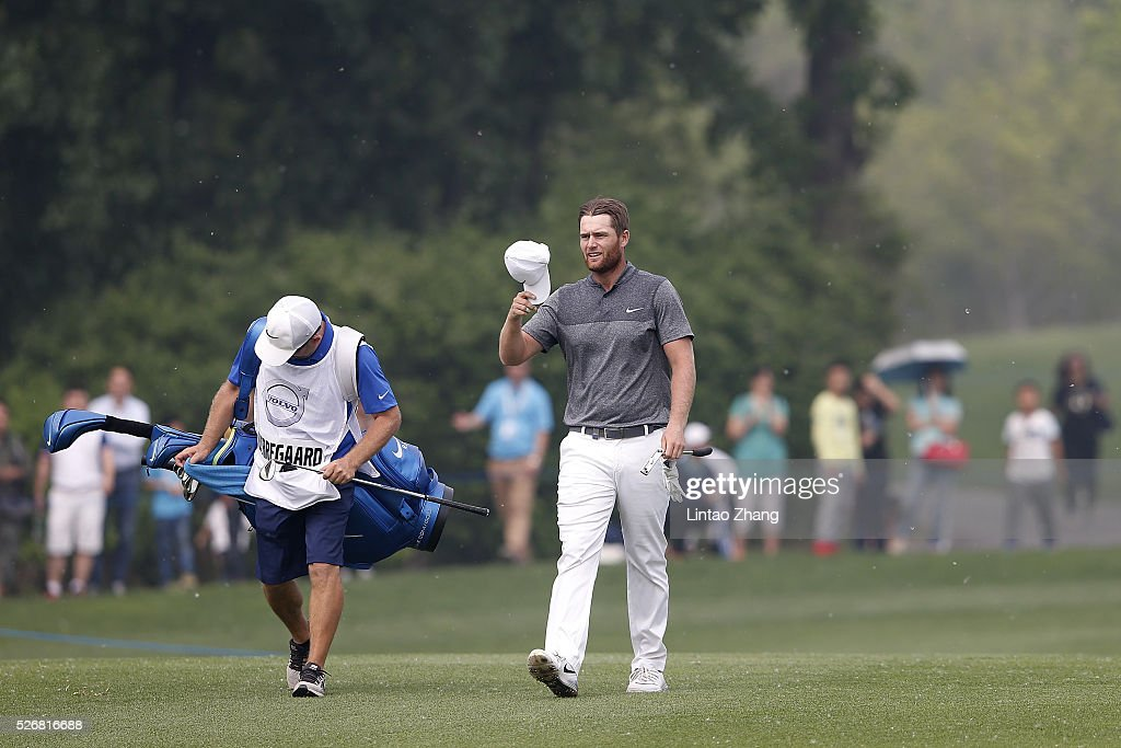 <a gi-track='captionPersonalityLinkClicked' href=/galleries/search?phrase=Lucas+Bjerregaard&family=editorial&specificpeople=6215709 ng-click='$event.stopPropagation()'>Lucas Bjerregaard</a> of Denmark waves his ball to the fans during the final round of the Volvo China open at Topwin Golf and Country Club on May 1, 2016 in Beijing, China.