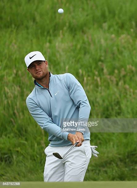 Lucas Bjerregaard of Denmarkchips onto the 9th green during day one of the 100th Open de France at Le Golf National on June 30 2016 in Paris France