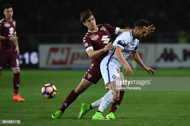 Lucas Boye of FC Torino clashes with Danilo D Ambrosio of FC Internazionale during the Serie A match between FC Torino and FC Internazionale at...