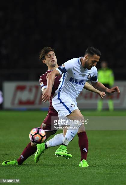 Lucas Boye of FC Torino competes with Danilo D Ambrosio of FC Internazionale during the Serie A match between FC Torino and FC Internazionale at...