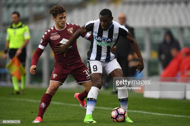 Lucas Boye of FC Torino competes with Duvan Zapata of Udinese Calcio during the Serie A match between FC Torino and Udinese Calcio at Stadio Olimpico...