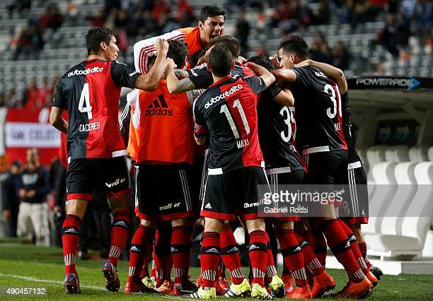 Lucas BoyeŽ of Newell's Old Boys celebrates with his teammates after scoring the first goal of his team during a match between Estudiantes and...