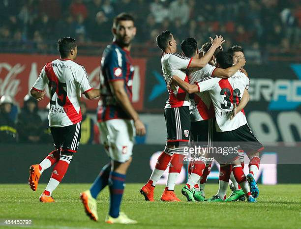 Lucas Boye of River Plate celebrates with his teammates after scoring the third goal of his team during a match between San Lorenzo and River Plate...