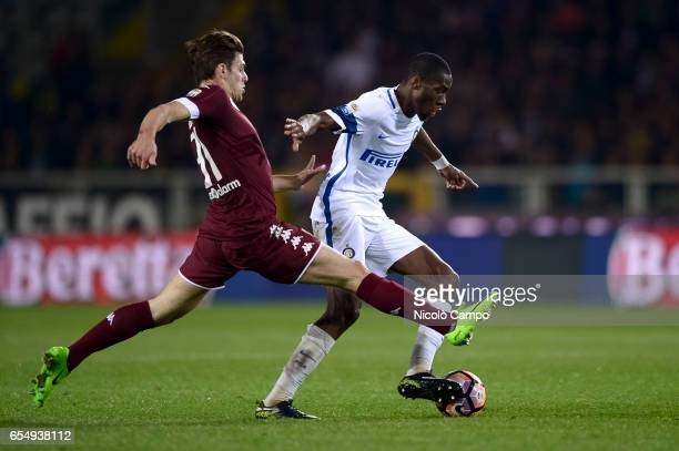 Lucas Boye of Torino FC and Geoffrey Kondogbia of FC Internazionale compete for the ball during the Serie A football match between Torino FC and FC...