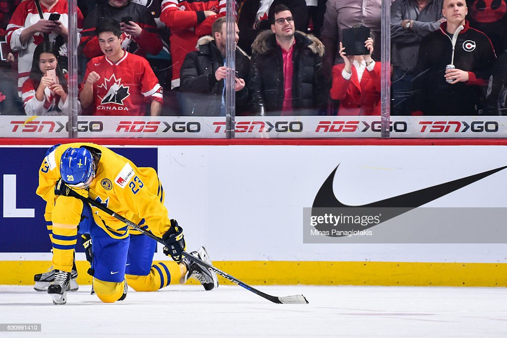Lucas Carlsson #23 of Team Sweden reacts after losing to Team Canada during the 2017 IIHF World Junior Championship semifinal game at the Bell Centre on January 4, 2017 in Montreal, Quebec, Canada. Team Canada defeated Team Sweden 5-2.