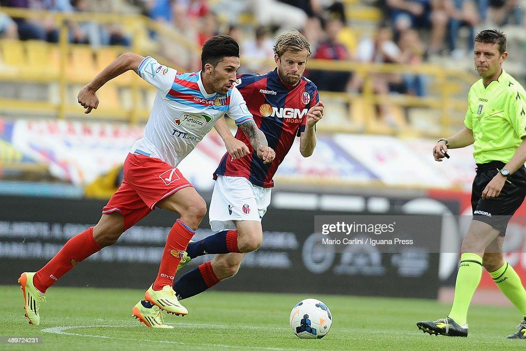 Lucas Castro of Calcio Catania competes the ball with Mikael Antonsson of Bologna FC during the Serie A match between Bologna FC and Calcio Catania...