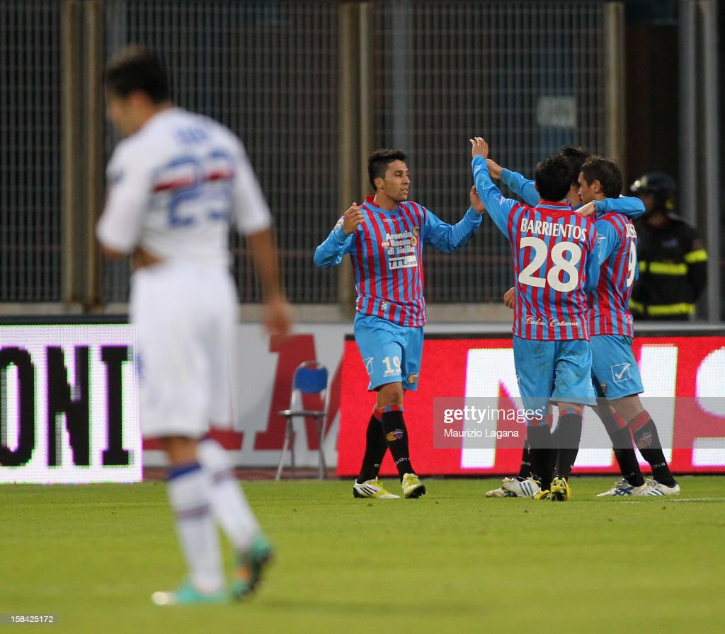 <a gi-track='captionPersonalityLinkClicked' href=/galleries/search?phrase=Lucas+Castro&family=editorial&specificpeople=5806212 ng-click='$event.stopPropagation()'>Lucas Castro</a> (L) of Catania celebrates after scoring the third goal during the Serie A match between Calcio Catania and UC Sampdoria at Stadio Angelo Massimino on December 16, 2012 in Catania, Italy.