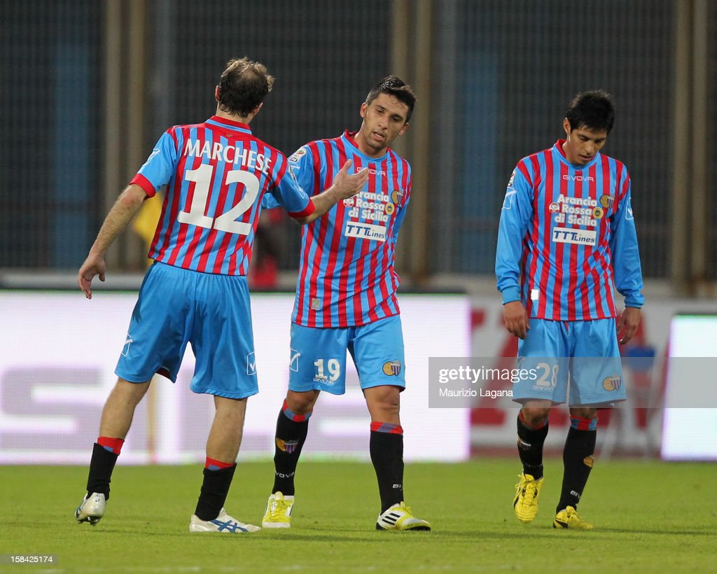<a gi-track='captionPersonalityLinkClicked' href=/galleries/search?phrase=Lucas+Castro&family=editorial&specificpeople=5806212 ng-click='$event.stopPropagation()'>Lucas Castro</a> (C) of Catania celebrates after scoring the third goal during the Serie A match between Calcio Catania and UC Sampdoria at Stadio Angelo Massimino on December 16, 2012 in Catania, Italy.