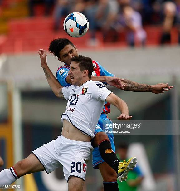 Lucas Castro of Catania competes for the ball in air with Sime Vrsaljko of Genoa during the Serie A match between Calcio Catania and Genoa CFC at...