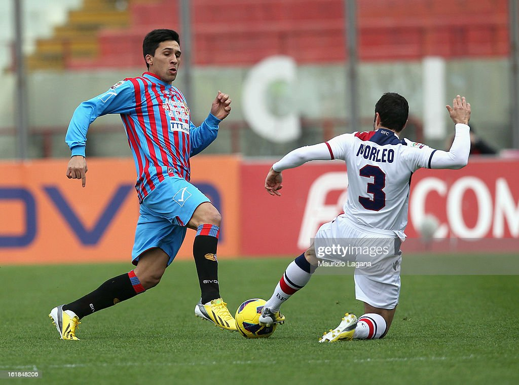 Lucas Castro (L) of Catania competes for the ball with Archimede Morleo of Bologna during the Serie A match between Calcio Catania and Bologna FC at Stadio Angelo Massimino on February 17, 2013 in Catania, Italy.
