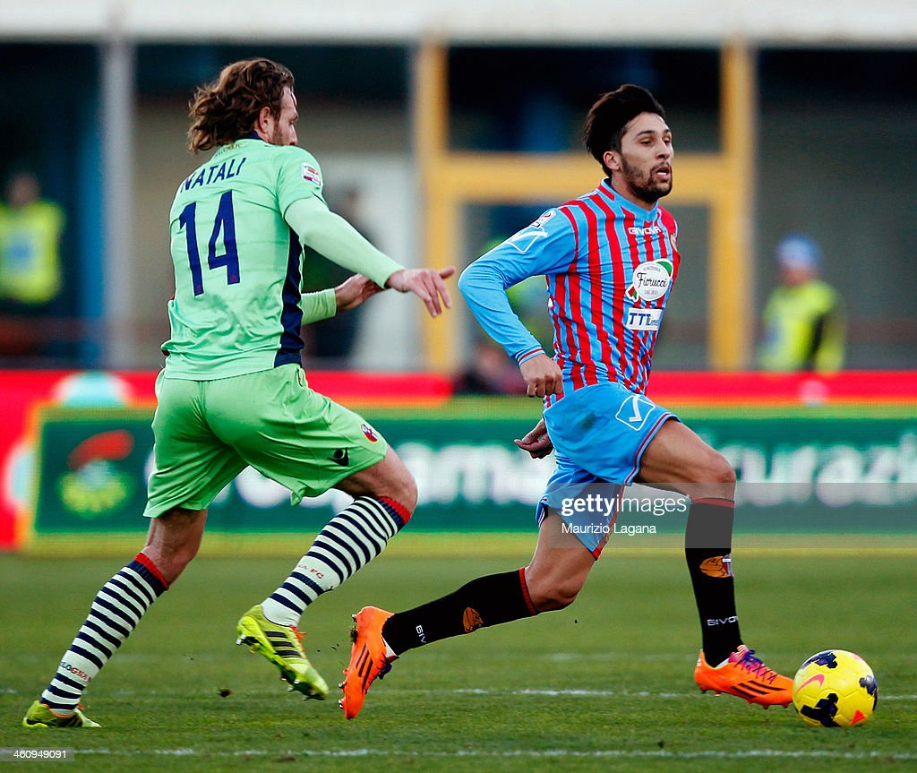 Lucas Castro of Catania competes for the ball with Cesare Natali of Bologna during the Serie A match between Calcio Catania and Bologna FC at Stadio...