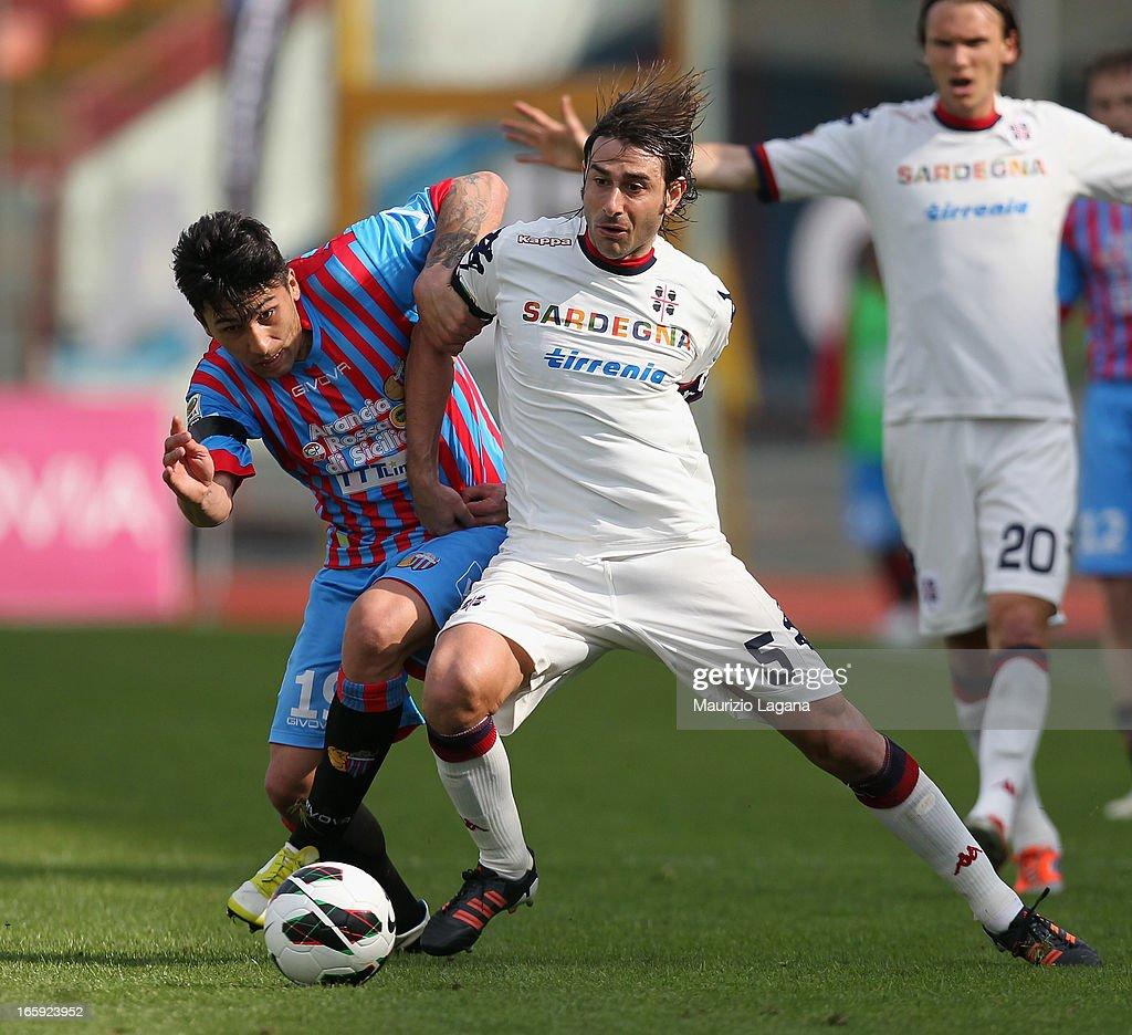 Lucas Castro of Catania competes for the ball with Daniele Conti of Cagliari during the Serie A match between Calcio Catania and Cagliari Calcio at...
