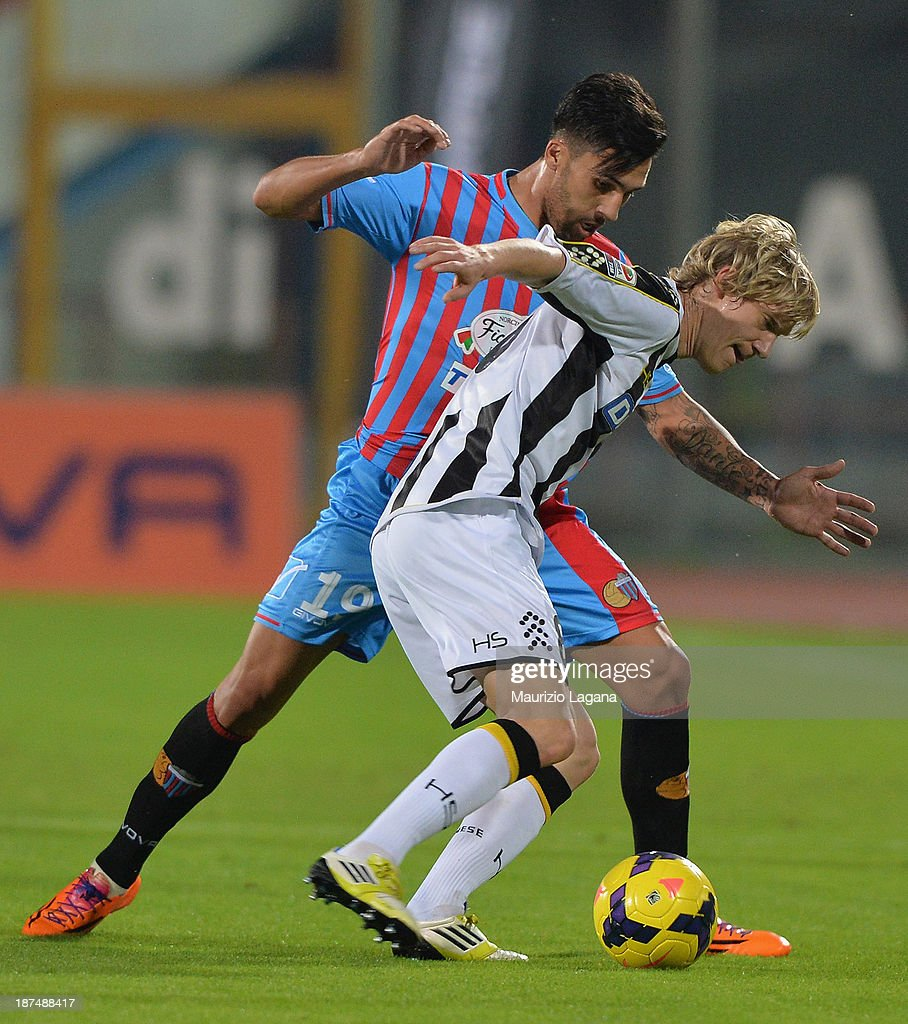 Lucas Castro of Catania competes for the ball with Dusan Basta of Udinese during the Serie A match between Calcio Catania and Udinese Calcio at...