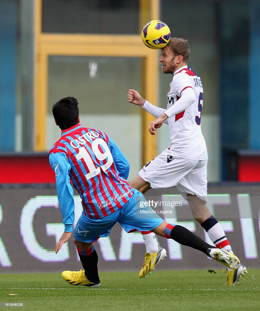 Lucas Castro (L) of Catania competes for the ball with Frederik Sorensen of Bologna during the Serie A match between Calcio Catania and Bologna FC at Stadio Angelo Massimino on February 17, 2013 in Catania, Italy.