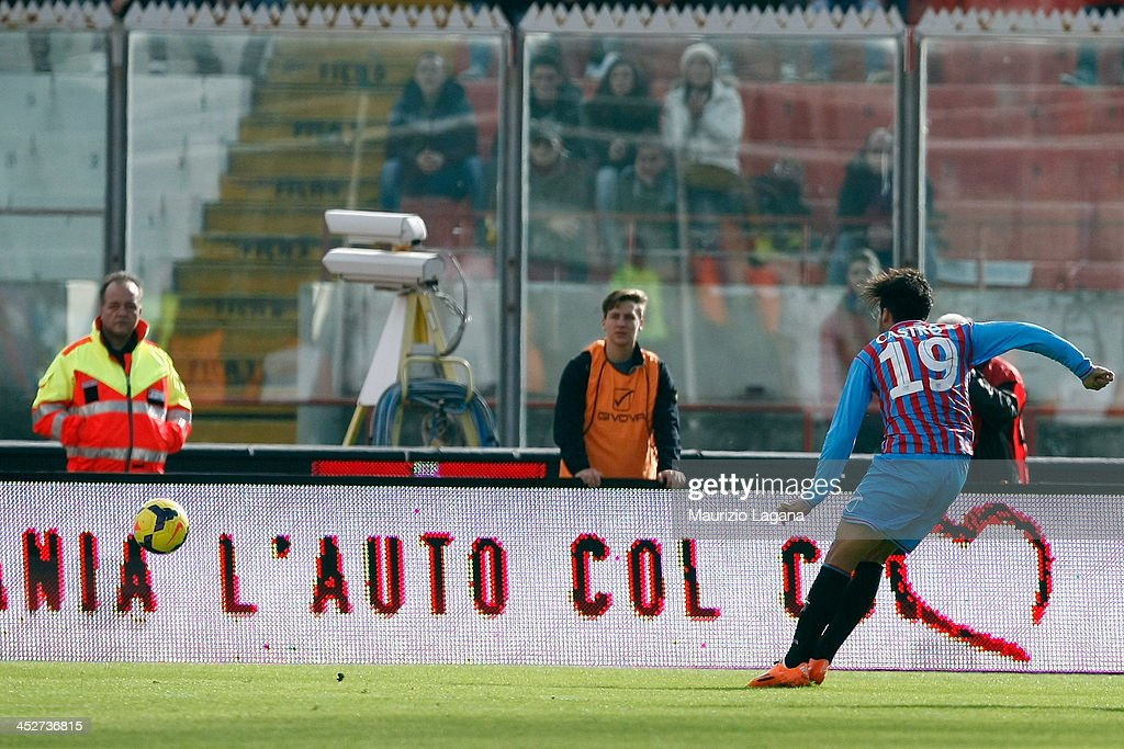 Lucas Castro of Catania scores his team's opening goal during the Serie A match between Calcio Catania and AC Milan at Stadio Angelo Massimino on...