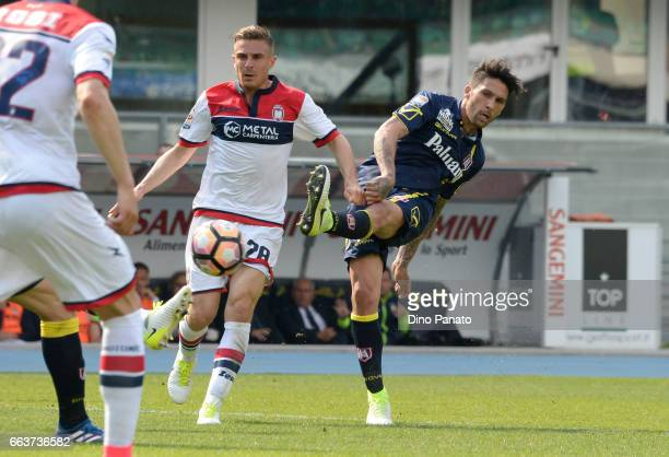 Lucas Castro of Chievo Verona competes with Leonardo Capezzi of Crotone during the Serie A match between AC ChievoVerona and FC Crotone at Stadio...