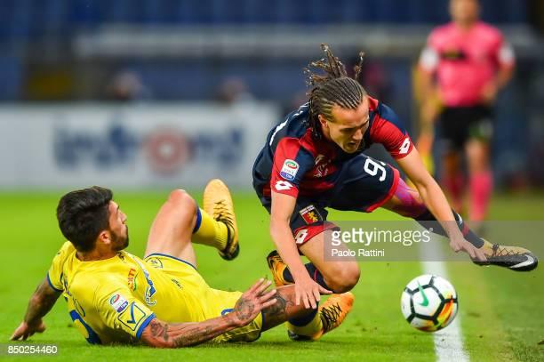 Lucas Castro of Chievo Verona tackles Diego Sebastian Laxalt of Genoa during the Serie A match between Genoa CFC and AC Chievo Verona at Stadio Luigi...