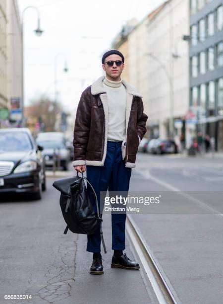 Lucas Christiansen wearing a brown leather jacket wool hat beanie navy pants backpack sunglasses sweater on March 22 2017 in Berlin Germany