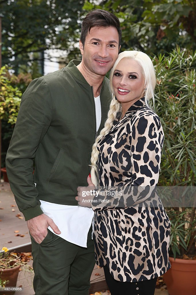 Lucas Cordalis and Daniela Katzenberger pose for a photograph during the launch of her new book 'Eine Tussi wird Mama' on October 13, 2015 in Duesseldorf, Germany.